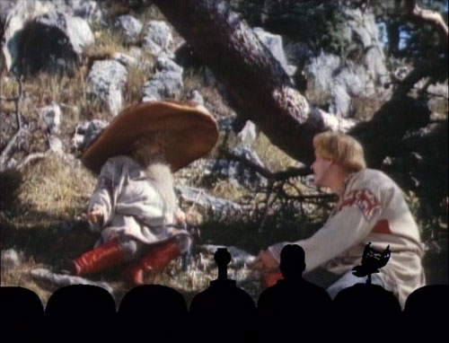 "Father Mushroom and Ivan from ""Jack Frost"" sitting in the forest with the MST3K silhouette in front"